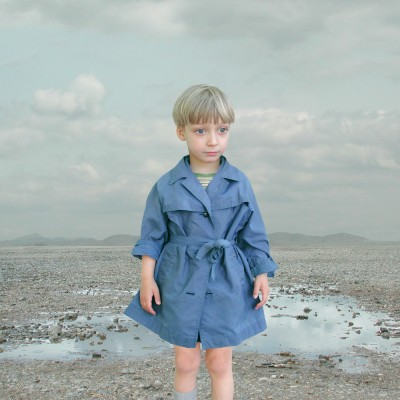 Boy in Blue Raincoat 1