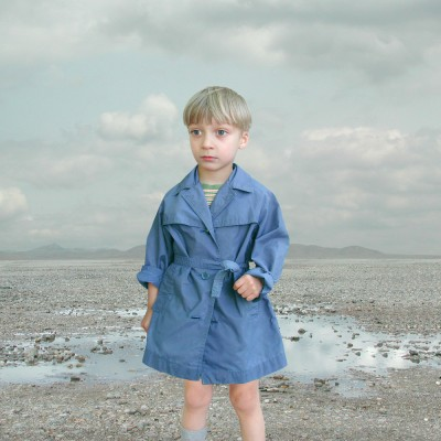 Boy in Blue Raincoat 2